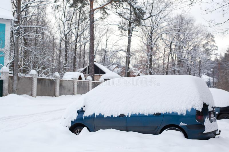Snow-covered cars in parking lot. heavy abnormal snowfall stock photography