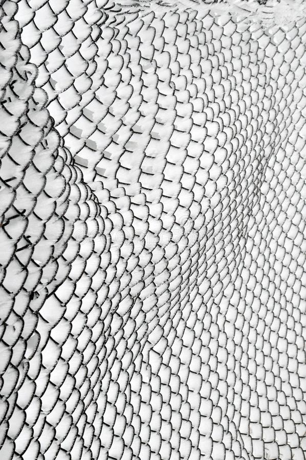 Snow Covered Chain Link Fence stock images
