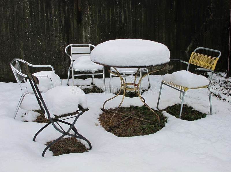 Snow Covered Chairs royalty free stock photography