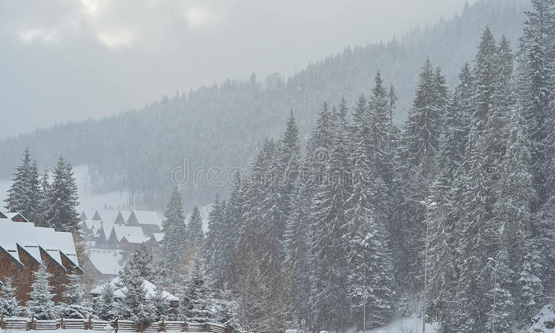 Snow covered chalet in the mountains, winter background with copy space. View of scenic white winter landscape with traditional mountain chalet, winter landscape stock images
