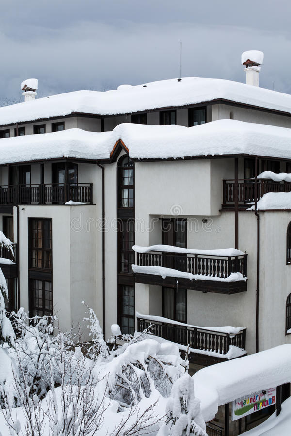 Snow covered chalets after the hard snowfall. Snow covered chalets after the very hard snowfall royalty free stock photo