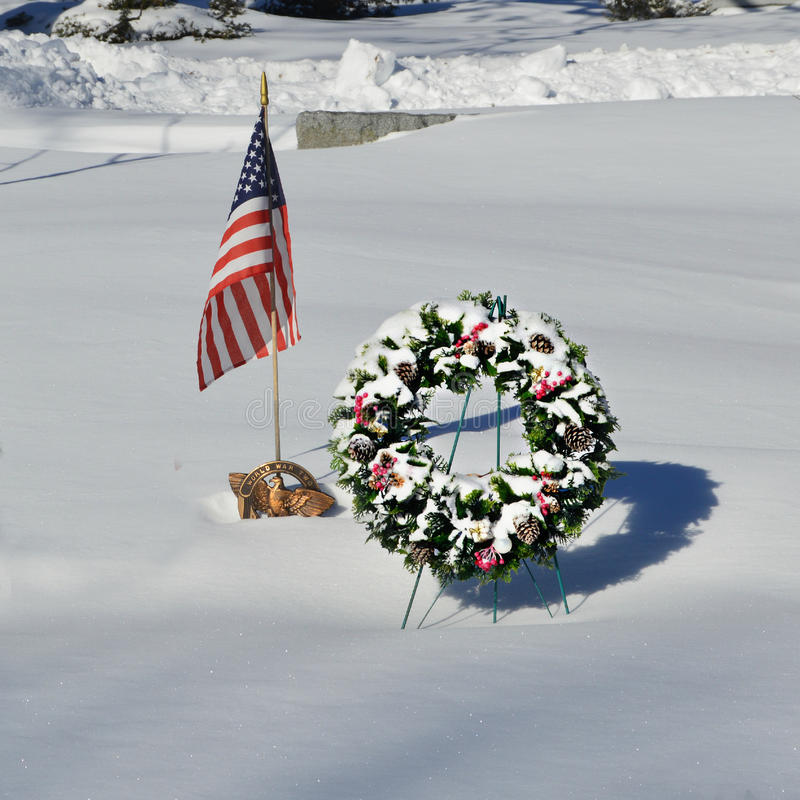 Snow Covered Christmas Wreath with American Flag royalty free stock photo
