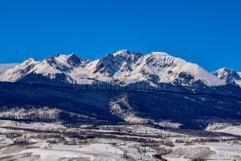 Snow covered Colorado Rockies Mountain Range in Winter. Snow covered peaks of the Colorado Rockies Gore Mountain Range with clear blue skys royalty free stock images