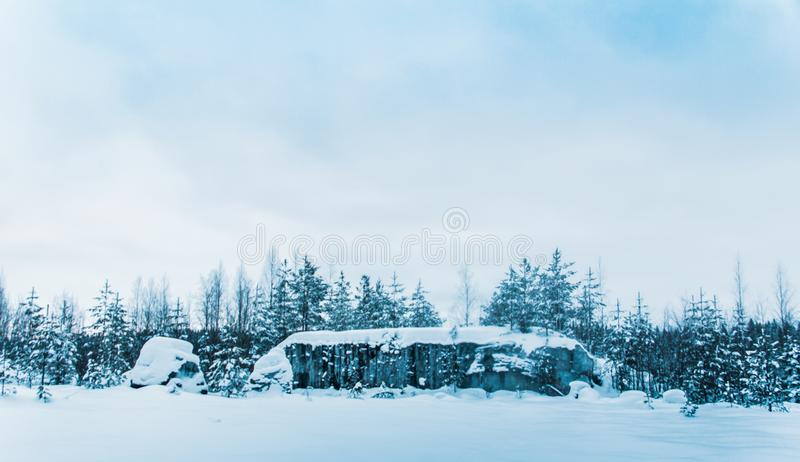 Snow-covered expanses of Karelia. And the pillars stand along the roads like crosses. Marble mines royalty free stock images