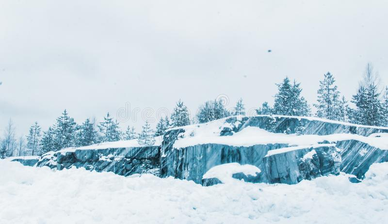 Snow-covered expanses of Karelia. And the pillars stand along the roads like crosses. Marble mines stock photography