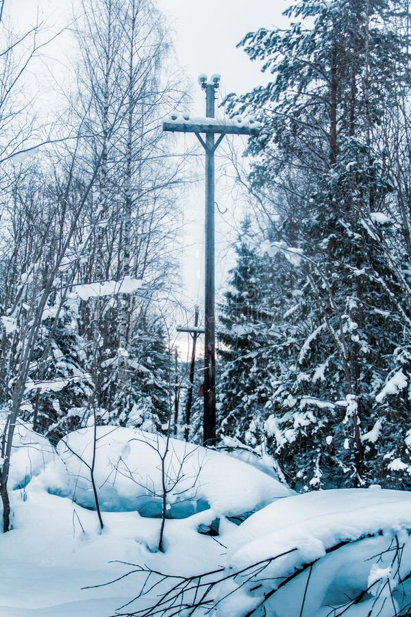 Snow-covered expanses of Karelia. And the pillars stand along the roads like crosses royalty free stock photo