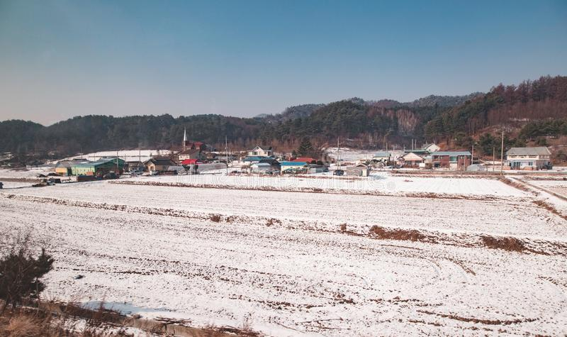 A snow covered field in Korea. An aerial view of a snow covered field during winter royalty free stock photos