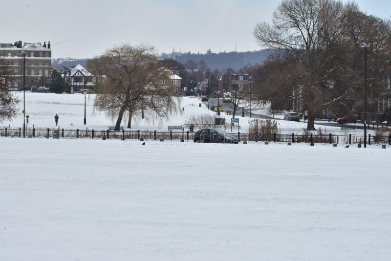 Snow covered fields in Blackheath London stock photo
