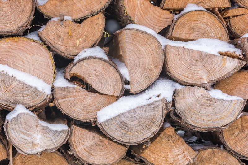 Snow-covered firewood during the heating season royalty free stock photography