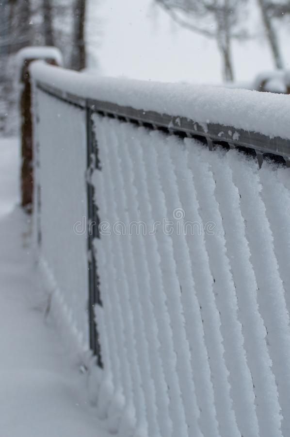 Snow-covered Geometric Fence in Finland stock photo