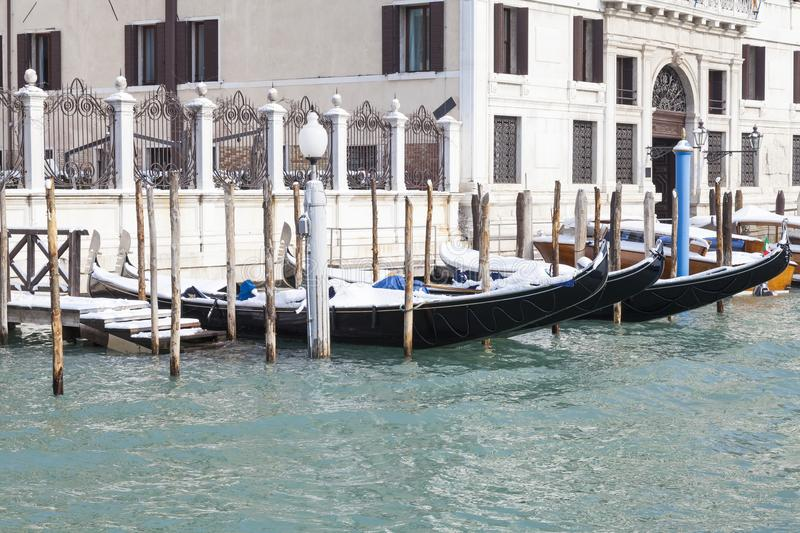 Snow-covered gondolas Grand Canal, San Polo, Venice, Italy. Snow-covered gondolas in front of a palazzo in the Grand Canal, San Polo, Venice, Veneto, Italy stock images