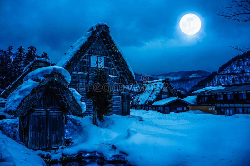 Snow covered the ground in winter. Town with night sky and full royalty free stock images