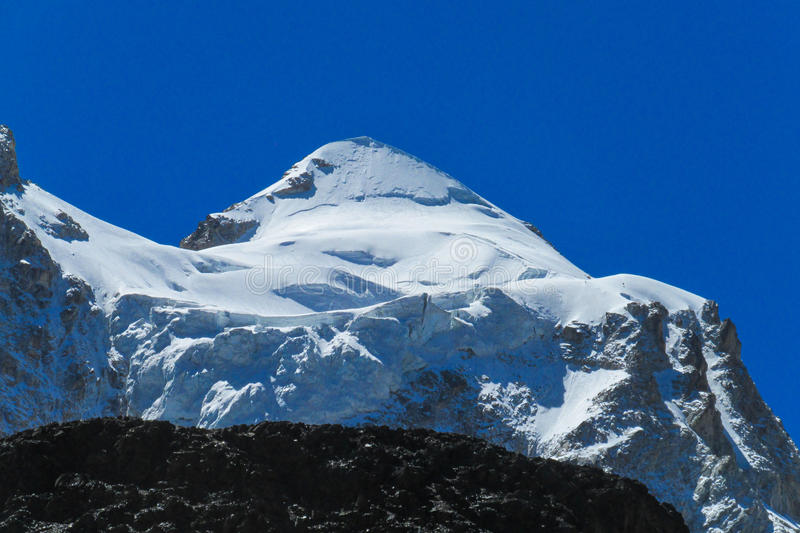 Snow covered high mountain in Andes. Beautiful trekking in the Andes, Huayna Potosi royalty free stock photography