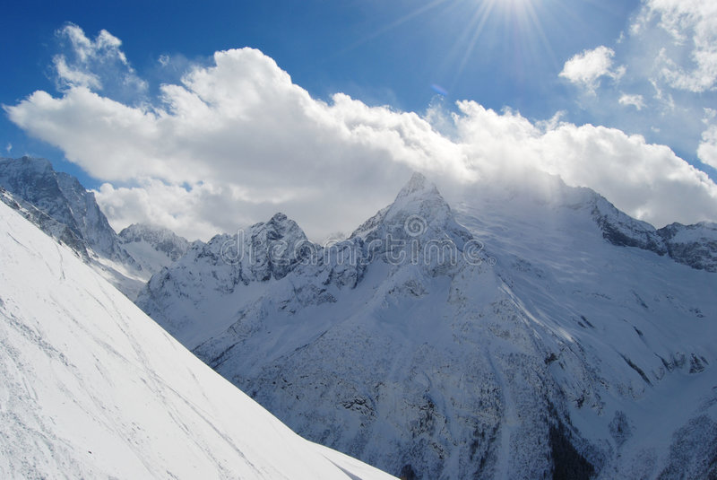 Snow covered high mountains royalty free stock photography