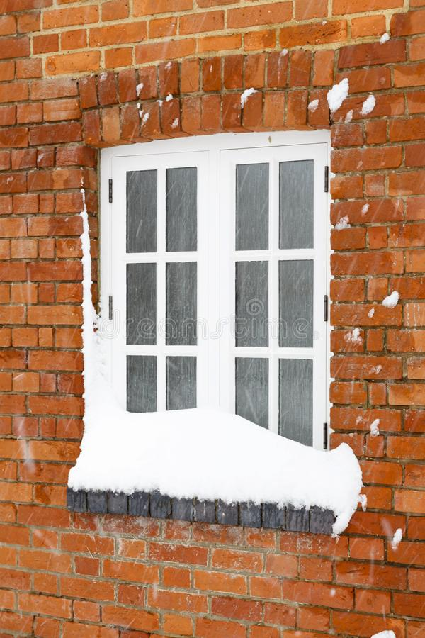Snow covered house window royalty free stock photo
