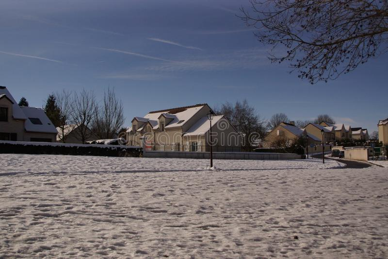 Snow-covered landscape - Town of Elancourt - France stock photography