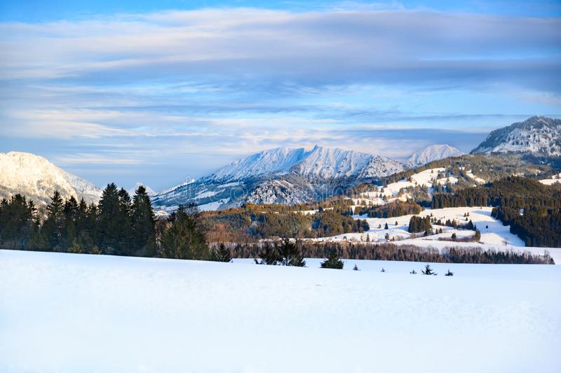 Snow covered landscape with view to Alps, Bavaria, Germany royalty free stock photo