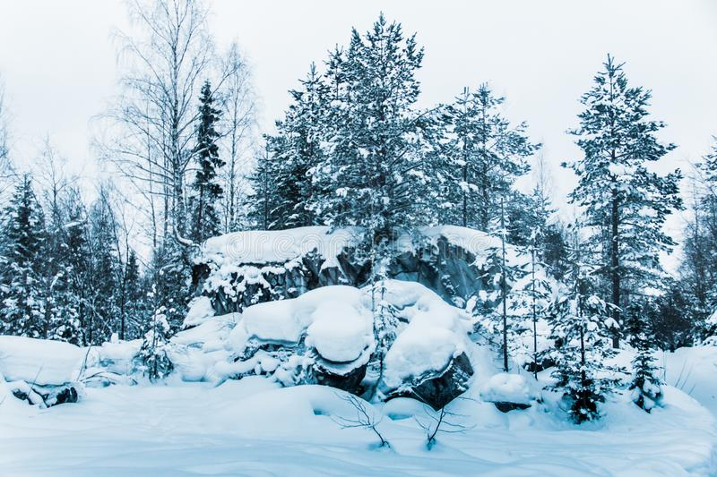 Snow-covered marble mountains of Karelia. The beauty of snow and ice royalty free stock photography