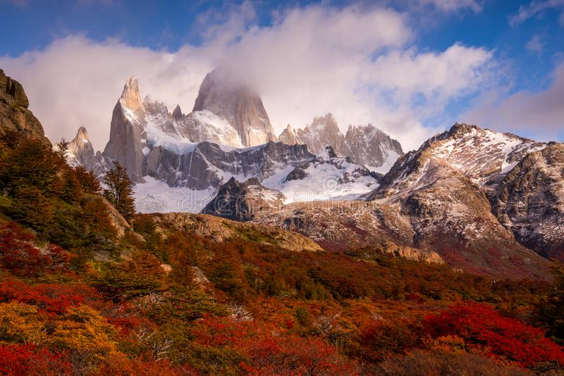 Snow-covered Mount Fitz Roy on beautiful fall day amongst forest of lenga trees. Hiking in Los Glaciares National Park on a beautiful fall day, taking in the stock photo