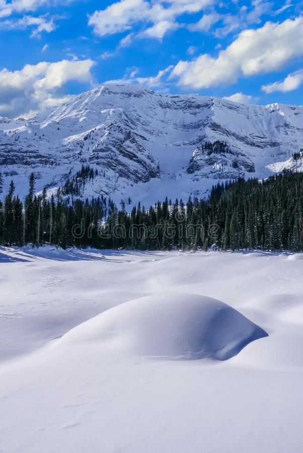 A snow covered mountain on a clear blue winter day in the Mountains at Black Prince Cirque in Kananaskis, Alberta stock image