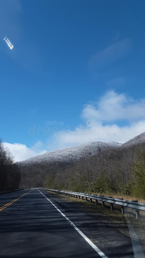 Snow covered Mountain. Cloud sunshine royalty free stock photo
