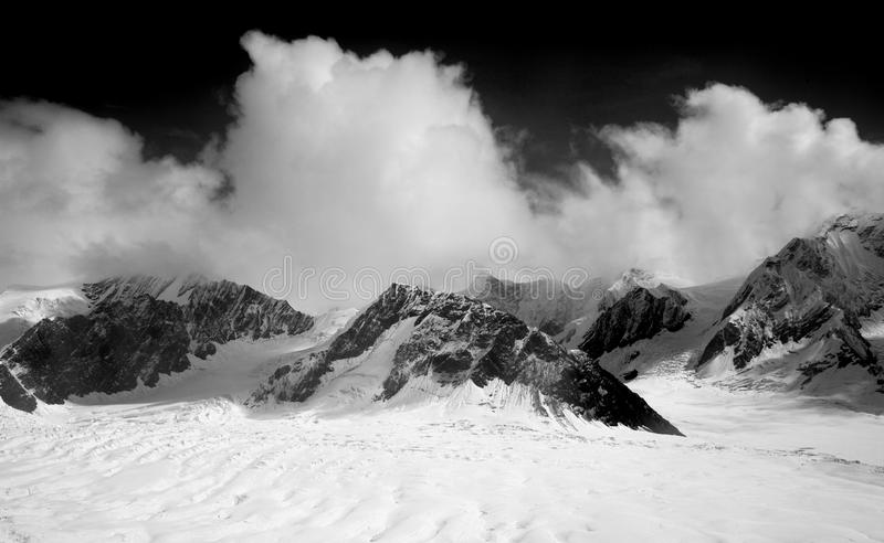 Snow Covered Mountain during Night Time royalty free stock images