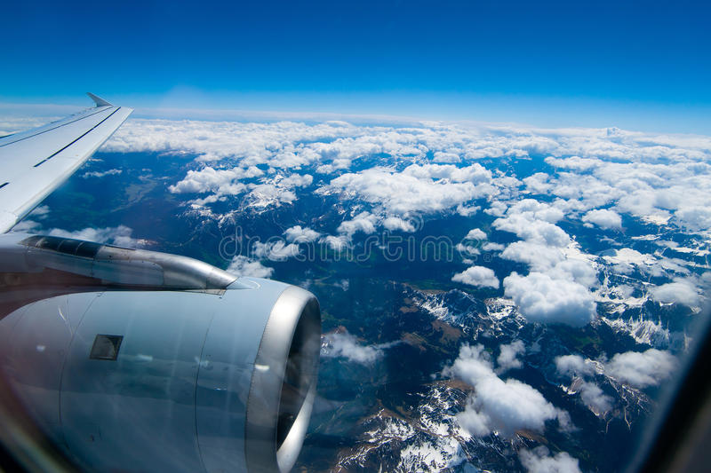 Download Snow-covered Mountain Peaks Clouds Peeking Stock Photo - Image: 26790490
