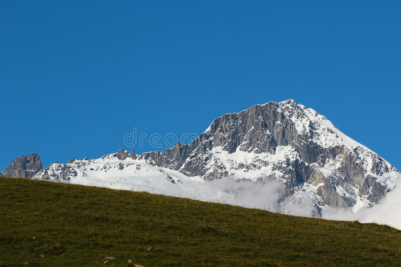 Snow covered mountains against blue sky background, Georgia, Caucasus. Mountains royalty free stock image