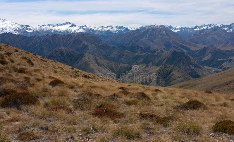 Snow covered mountains as seen from the top of the Ben Lomond Peak near Queenstown, New Zealand royalty free stock photography