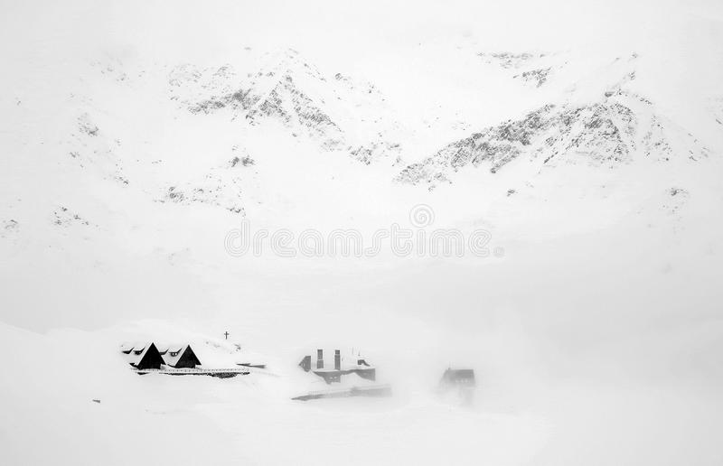 Spectacular winter landscape wooden chalets in Fagaras mountains. Snow covered mountains at Balea Lake, Transylvanian Alps, Romania, Europe royalty free stock image