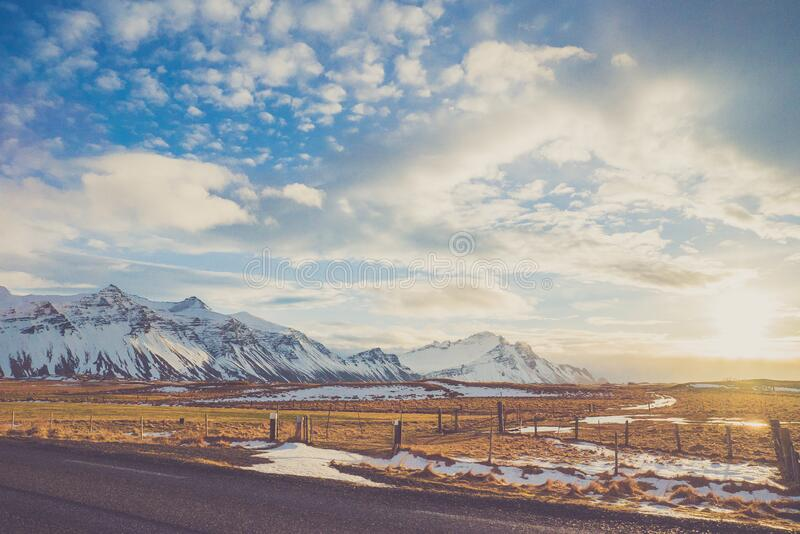 Snow covered mountains in countryside royalty free stock photography