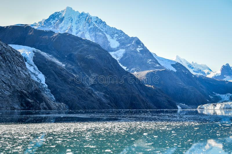 Snow covered mountains with pieces of ice from glaciers floating stock photo