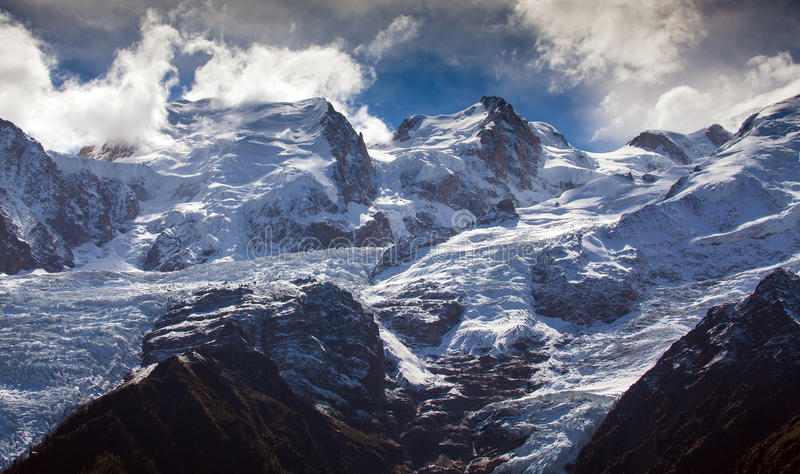 Snow covered mountains and rocky peaks in the Alps. Snow covered mountains and rocky peaks in the French Alps in the Mont Blanc Massif stock photo