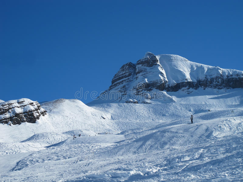 Snow covered Mountains,and ski slope stock photos