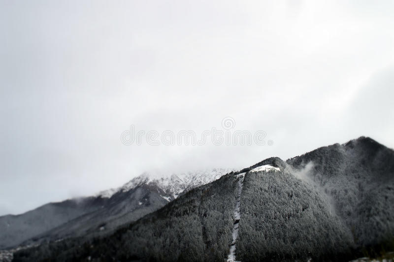 Snow Covered Mountains and Sky royalty free stock photography