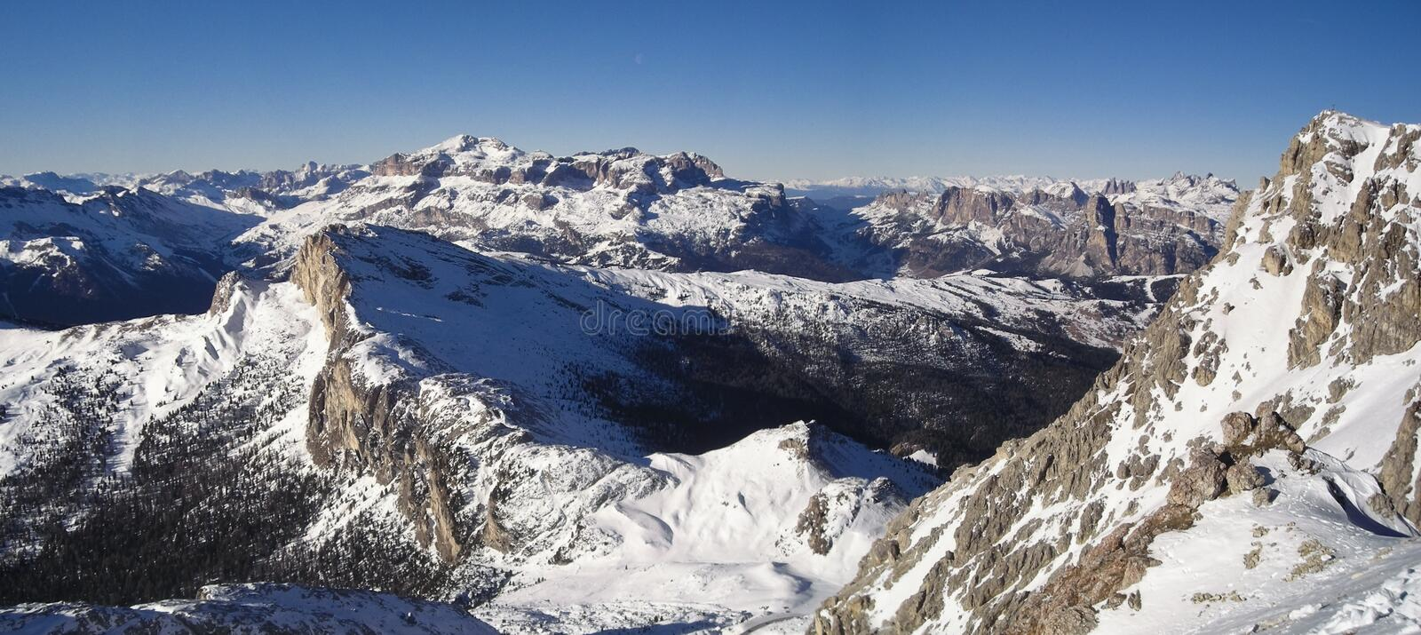 Snow covered mountaintops. Winter view of mountain landscape from the top of Lagazuoi in a sunny day - Dolomites, Italy 2007 royalty free stock images