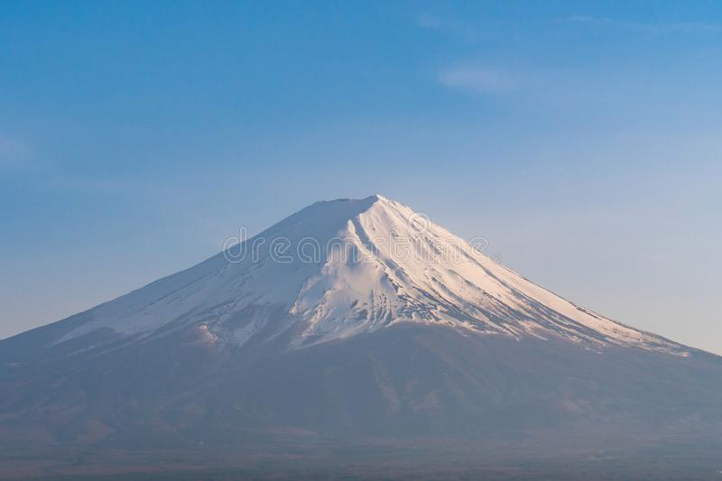 Snow covered Mt. Fuji with blue sky in spring season royalty free stock photography