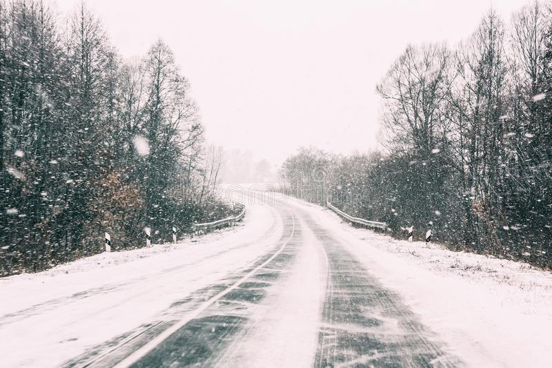 Snow-covered Open Road During A Winter Snowstorm. Adverse Weather. Conditions royalty free stock photography