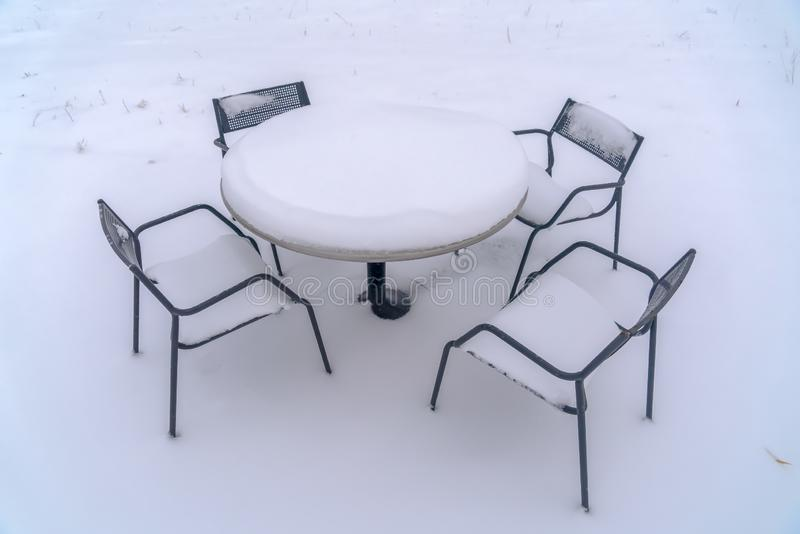 Table And Chairs Covered By Snow Stock Image - Image of ...