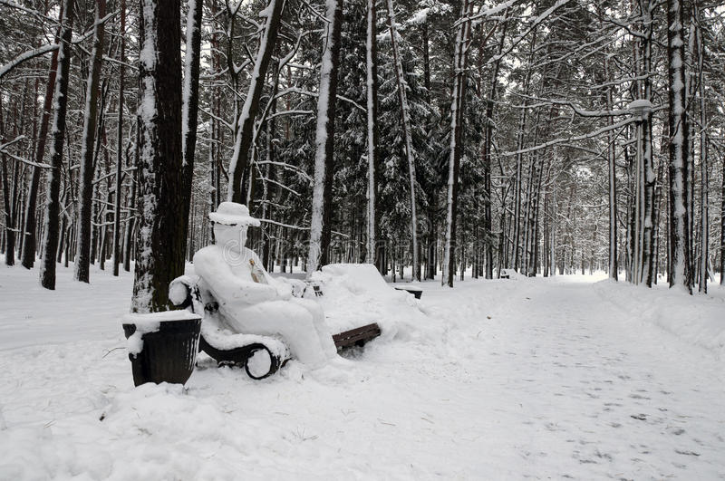 Download Snow-covered Park Bench With Yeti Man Stock Photo - Image: 17744254