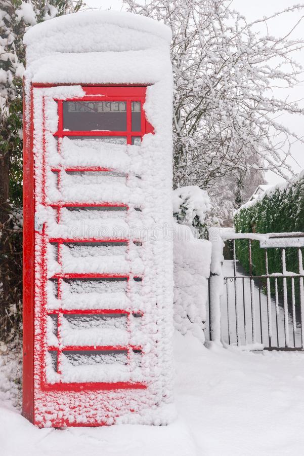 Snow covered British red phonebooth royalty free stock images
