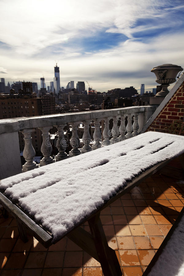 Free Snow Covered Picnic Table & New-York Skyline Royalty Free Stock Photo - 29881155