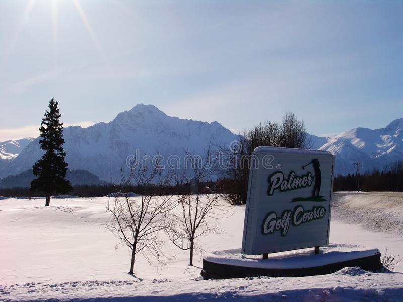 Pioneer Peak Mountain Palmer Alaska. Snow covered Pioneer Peak Mountain with golf course in foreground in Palmer, Alaska royalty free stock images