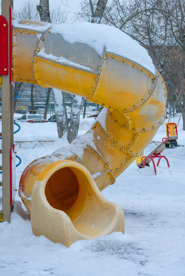 Snow-covered playground in winter square in Russia. royalty free stock images