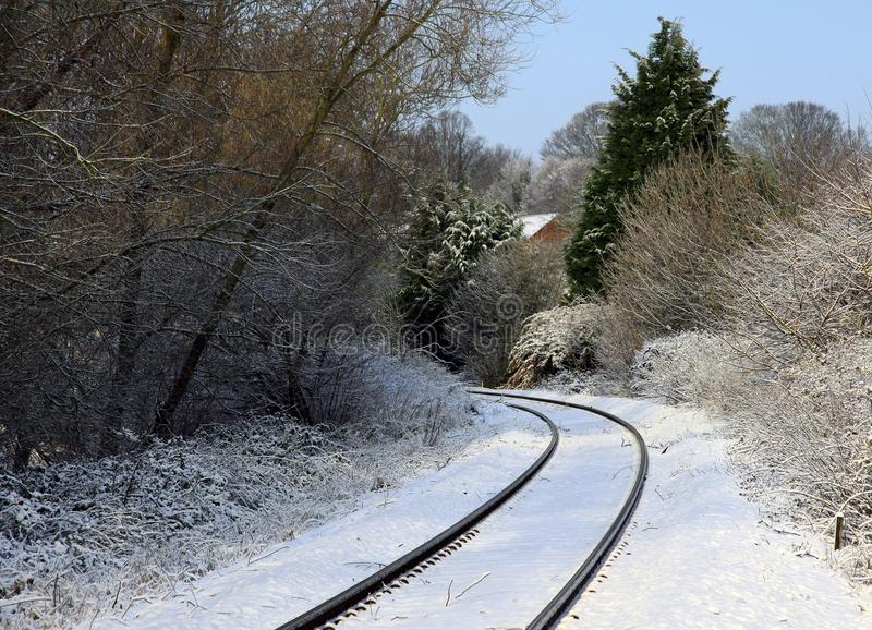 Snowy railway tracks. The snow covered railway tracks leading to the station in Sudbury Suffolk royalty free stock photography