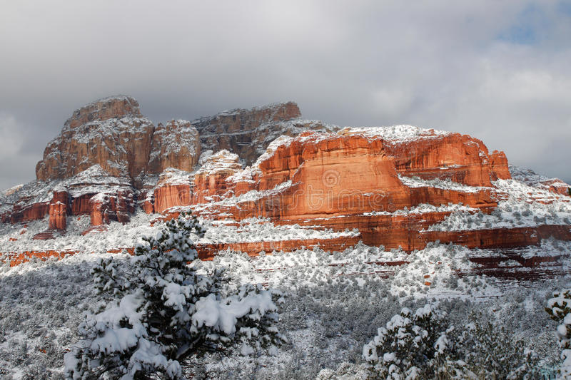 Snow-covered red rocks royalty free stock photography