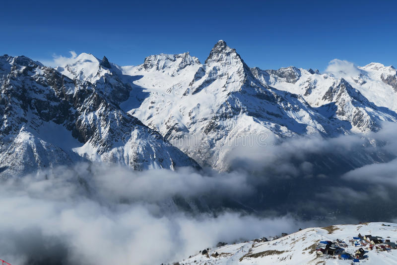 Snow Covered Rocky Mountains Under Blue And White Cloudy Sky Free Public Domain Cc0 Image