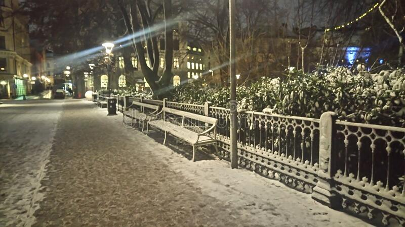 Snow covered sidewalk and street royalty free stock photo