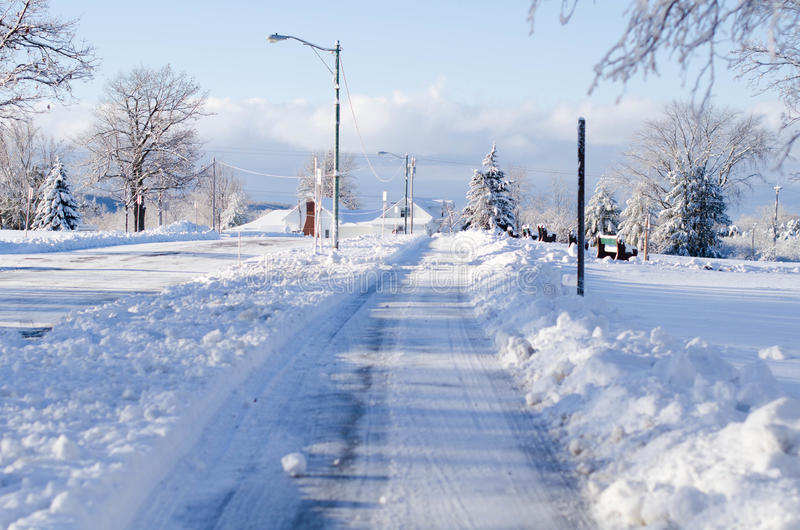 Snow covered sidewalk. In upstate New York royalty free stock image