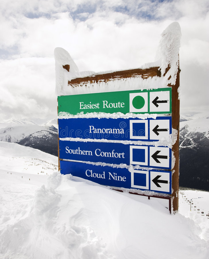 Snow covered sign. stock image